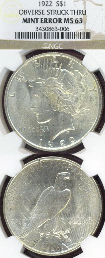 1922 $ Obverse Stuck Thru US Peace silver dollar